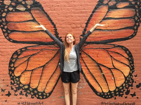 Andrea Ehrhardt, 28, painted this butterfly and is
