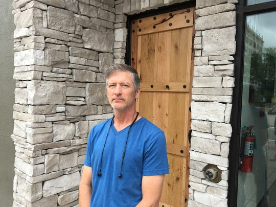 Kyle Cristoffer and his wife, Mary, have refurbished their 19th century building at 108 Park Central Square.