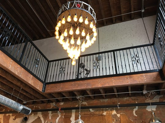 Kyle Cristoffer made the chandelier, which is on a pulley system that lowers it and lifts it.