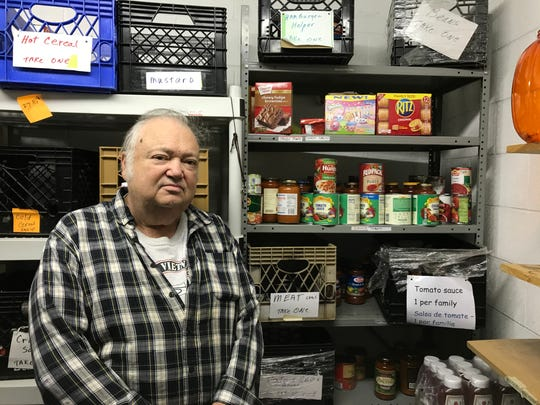 Co-Manager Pat Keating keeps tabs on inventory at St. Agnes' Episcopal Church's Food Pantry in Little Falls on May 22, 2018.