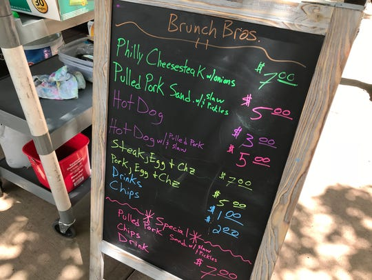 The chalkboard menu at Brunch Bros. BBQ in Old Town