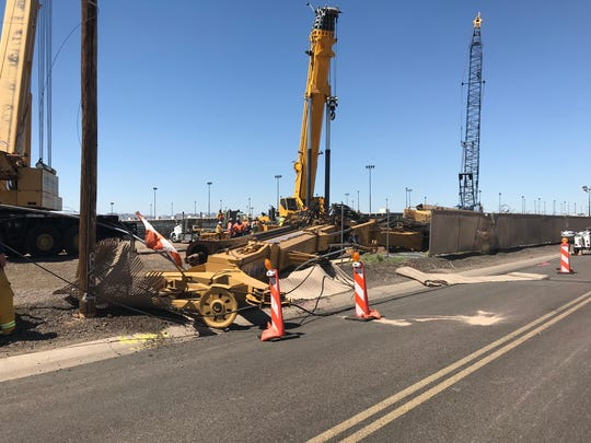 Crews attempt to clear the collapsed equipment on May 22, 2018, where a worker is believed dead following a work-site incident at Phoenix Sky Harbor International Airport the day before.
