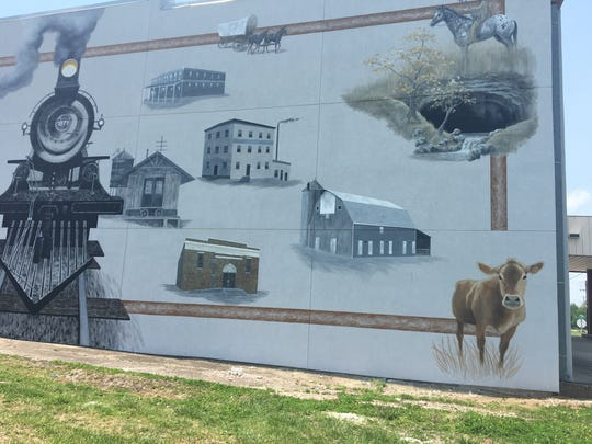 Artist Susan Luarca is painting a mural on the east wall of Billings City Hall.
