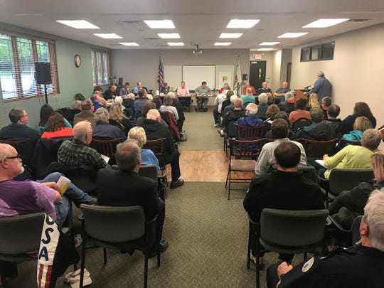 More than 50 Thiensville residents attended a public hearing regarding a proposed 27-unit condominium development north of Lumen Christi Church on Monday, May 21.