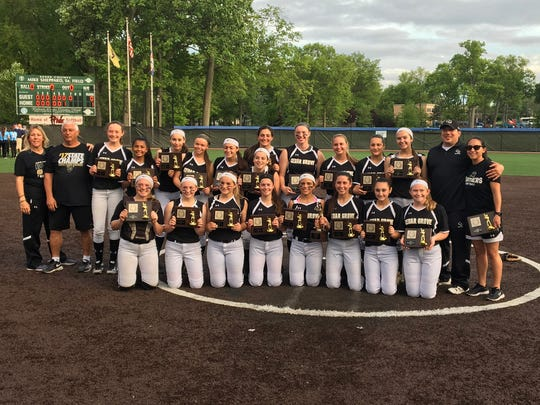 Cedar Grove's softball team poses with the program's first county title since 2010.