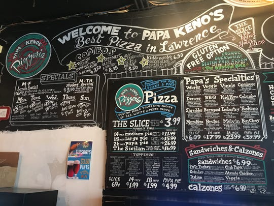 The menu board of a Papa Keno's in Lawrence, Kansas