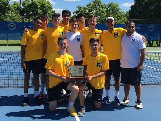 Montgomery High School's boys tennis team holds the