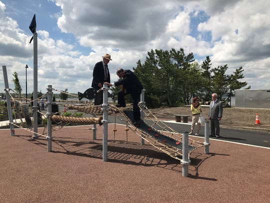 Ocean County Freeholder Gerry P. Little (right) climbs