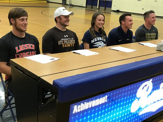 Five Reed senior signed for college on Wednesday. Left to right, Brandon Biggs; Scott Walsh; Erica Robtoy; Josiah Schmidt; and Austyn Mitchell