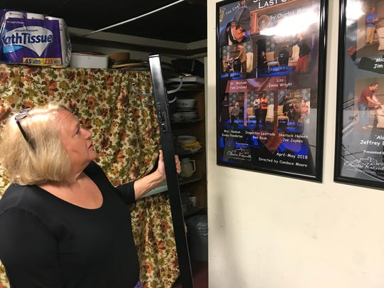 Bonny Pendleton, president of Theatre Knoxville Downtown, looks at a recent production poster at the theater on May 23, 2018.