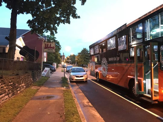 A tour bus stops outside Bobby's Idle Hour shortly