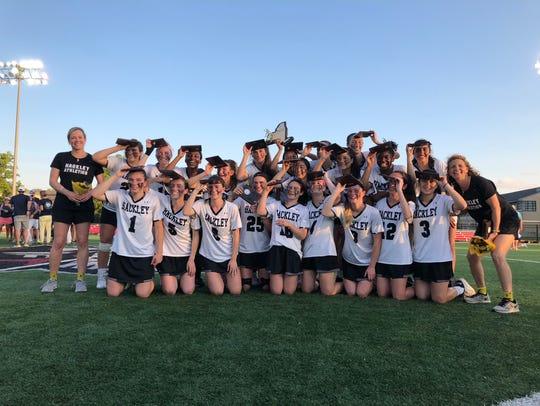 Hackley's girls lacrosse team celebrates after winning