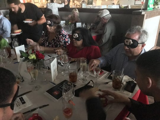 The novelty of eating with a blindfold wore off quickly