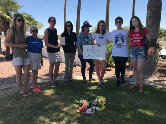 A group of animal activists gathers in Scottsdale on May 23, 2018, during a memorial for Alia, a dolphin that died May 22, 2018.
