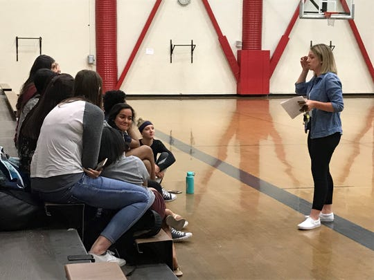 Katie Lawrence talks to the returning Wooster volleyball players after being introduced Thursday as the next head coach.