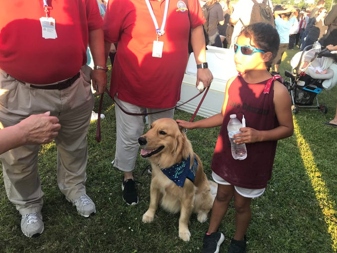 Gabriel, a trained comfort dog from Houston, receives