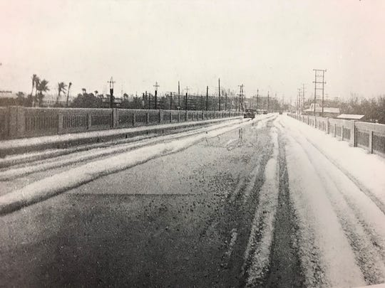 "In this photo by Frances Carlberg King in ""Stuart on the St. Lucie: A Pictorial History"" by Sandra Henderson Thurlow, hail covers the old Roosevelt Bridge on Feb. 10, 1934."