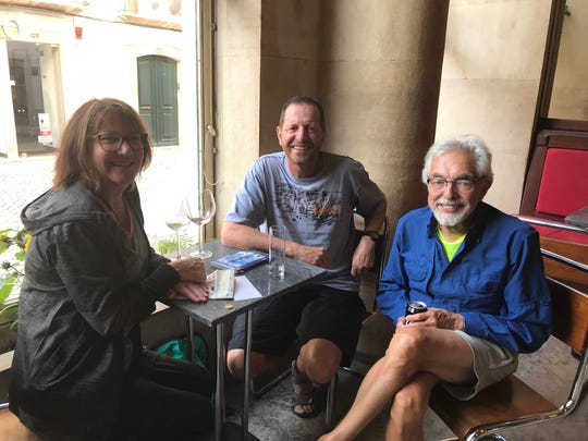 Jerry Osteryoung, right, has drinks with Liz and Robert Taylor from Australia.