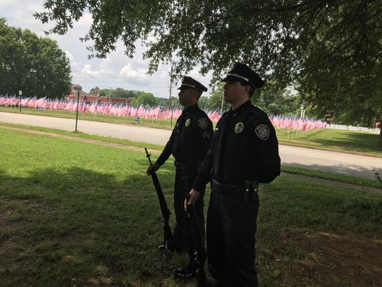 Two members of the JPD Honor Guard stand at attention during the Flags of Freedom ceremony last Tuesday.