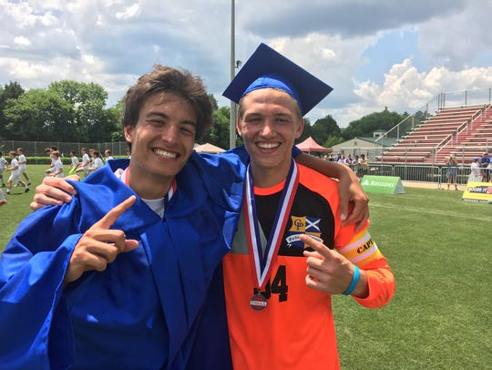 Derek Martin, left, and Joey Renfro, wear part of their graduation gear following Gatlinburg-Pittman's 2-1 victory to win the Class A state soccer championship in Murfreesboro on Friday, May 25, 2018.