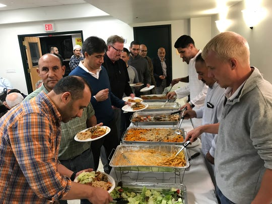 Members and guests share an interfaith Iftar dinner on Sunday, May 27, 2018, at Jam-e-Masjid Islamic Center in Boonton, N.J.
