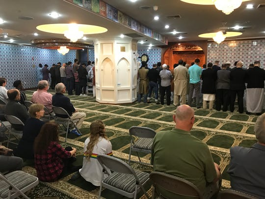 With guests invited to observe, Muslims pray after breaking fast, and before hosting an interfaith Iftar dinner on Sunday, May 27, 2018, at Jam-e-Masjid Islamic Center in Boonton, N.J.