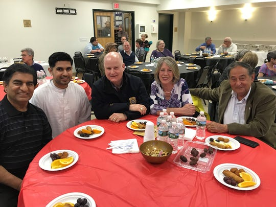 From left, Syed Bokhari, Afsal Amanat, Morris County Sheriff James Gannon, Morris County Freeholder Deborah Smith and Boonton Alderman Cyril Wekilsky share a table at an interfaith Iftar dinner on Sunday, May 27, 2018, at Jam-e-Masjid Islamic Center in Boonton, N.J.