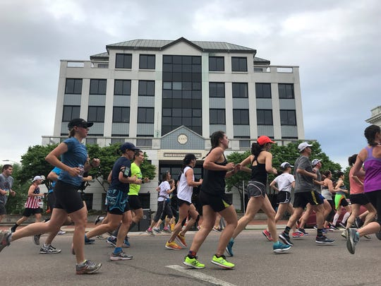 Runners make their way down Main Street in the 2018