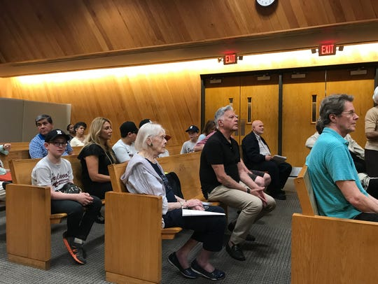 Members of the public listen at Englewood's City Council