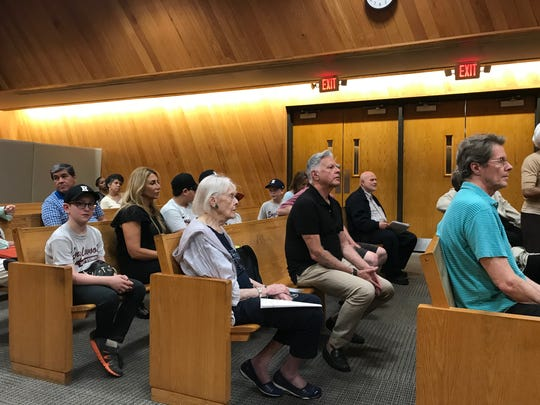 Members of the public listen at Englewood's City Council meeting on Tuesday, May 29, 2018.