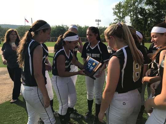 Cedar Grove softball players admire its North 1, Group 1 sectional title trophy after a 7-0 win over Hasbrouck Heights.