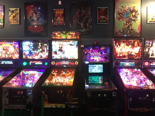 Token Game Tavern feels like stepping into a neon time machine. Gaming memorabilia line the walls, and mounted TVs skip sports in favor of broadcasting video games.