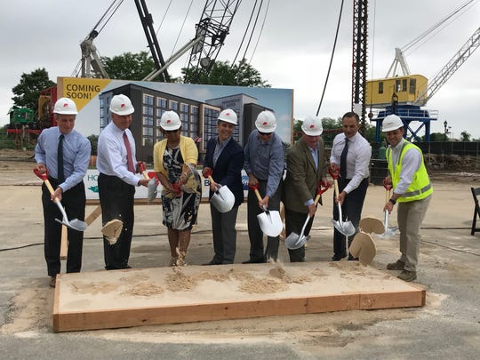 A groundbreaking ceremony for the Buccini/Pollin Group's new Homewood Suites hotel.