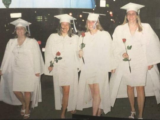 From left to right, Amanda Hopkins, Kristen Felix, Mallory Mitchel and Kristen (Sunderhaus) Dupps at Mother of Mercy High School's 2004 graduation.