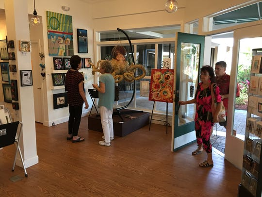 Visitors at DAAS Co-Op art gallery in Royal Palm Square