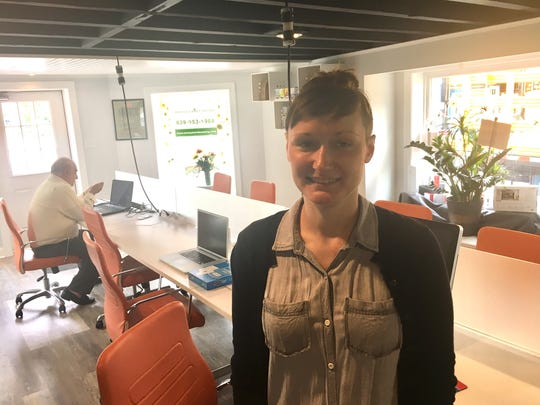 Elise Chepurny, the director of marketing at Lakes Workspace, is shown in the front area of the new coworking space located in Medford Lakes.