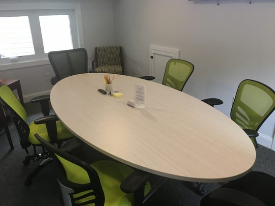 A second-floor conference room is shown at Lakes Workspace in Medford Lakes.