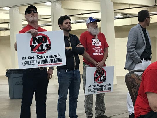 Opponents of the future Major League Soccer stadium. dressed in red, were present at Tuesday night's meeting where metro officials and architects proposed an updated master plan for a dramatically revamped Fairgrounds Nashville on Tuesday, May 29, 2018.