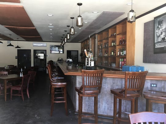 Tap handles and barstools remain in place nearly eight