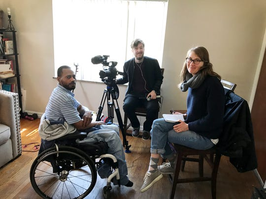Trace reporter Elizabeth Van Brocklin, right, poses with Cincinnati Enquirer audio engineer Phil Didion after an interview with shooting survivor Will Thomas, left, on April 8, 2018.