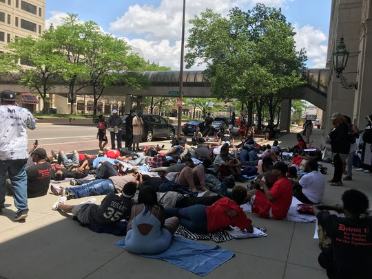 All the protesters laid down on the ground to listen