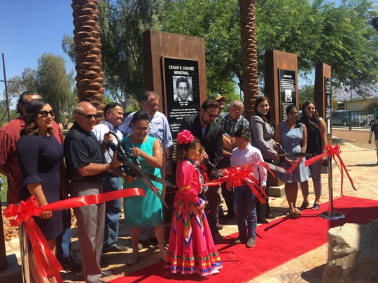 Coachella City Council member Steve Brown, organizer Clementina Olloque, Mayor Steven Hernandez and Mayor Pro Temp Betty Sanchez cutting the ceremonial ribbon, officially dedicating a monument and re-naming Coachella's former Harrison Street in the labor leader's honor.