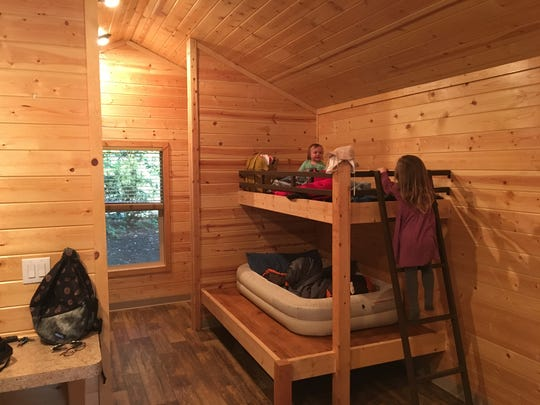The new cabins in the Redwood National and State Park system can sleep around 6 people.