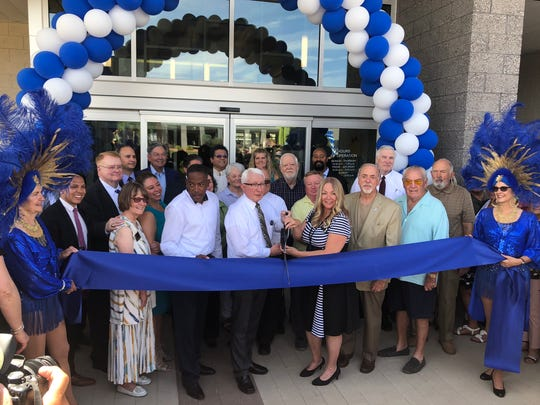 LVCCLD Board of Trustees Chairman Randy Ence and branch manager of the Mesquite Library Campus Judi Sargent cut the ribbon at the Mesquite Library Grand Opening on May 31.