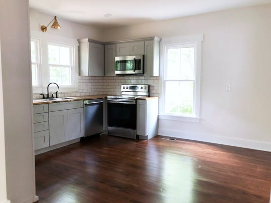 After: The opening to the kitchen was enlarged to allow more light in and create a proper eat-in kitchen.