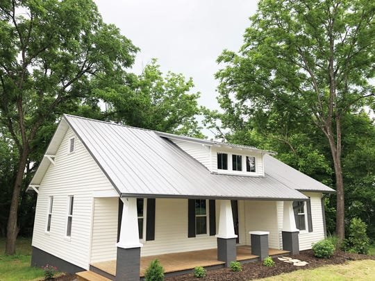 """After: """"The cool front porch makes it a true Craftsman Bungalow,"""" said Bailey. When it came to selecting the right paint and stains, Bailey had his nephew Clay Payne of Knoxville Coatings and Supply help pick out the perfect interior, exterior and floor colors."""