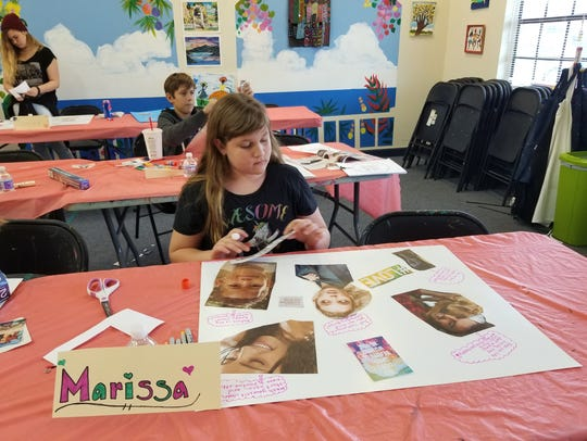 Marissa Brodie works on her collage during one of the