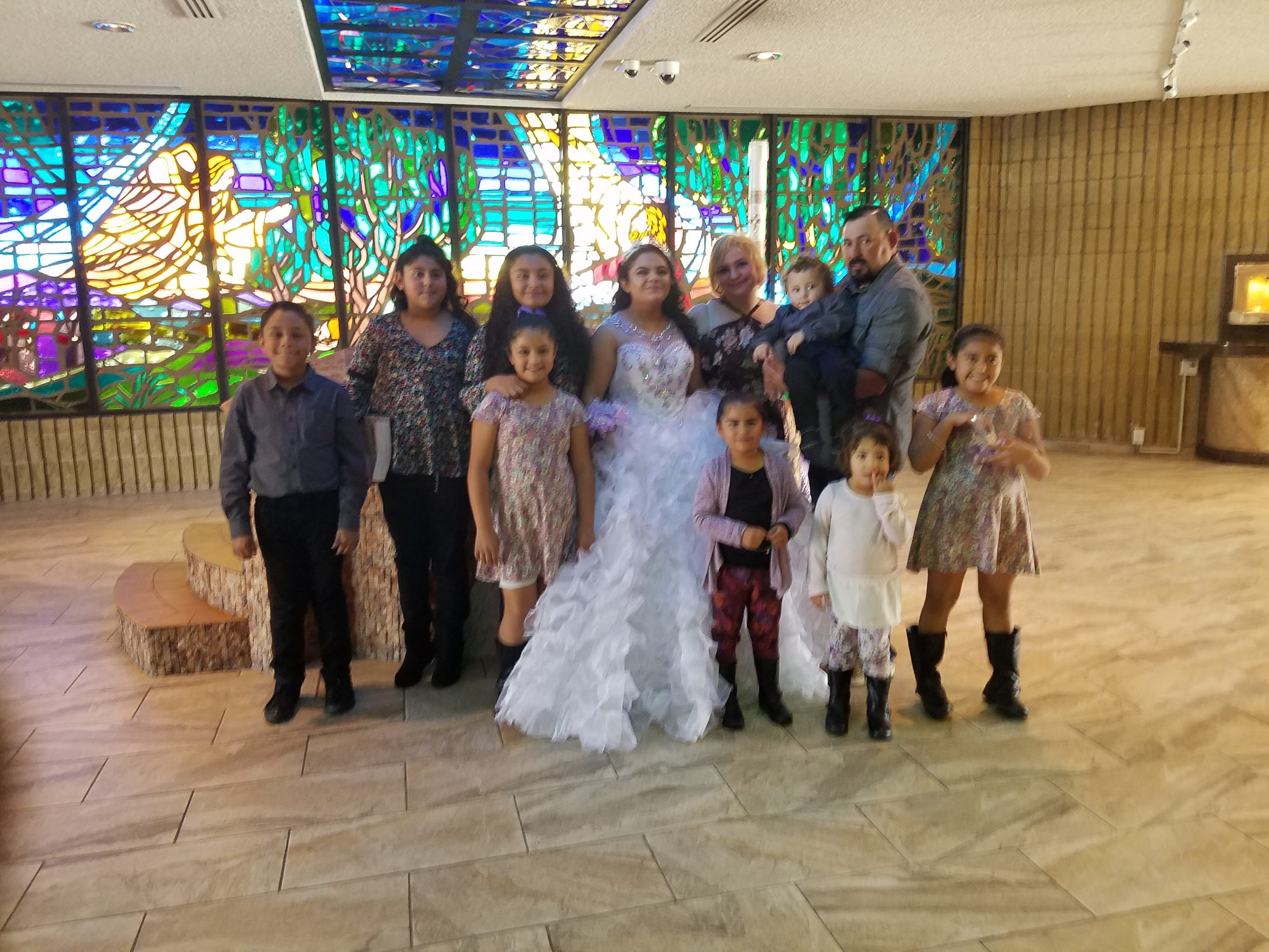 Carla Gabrielle Ballesteros with her family at her quinceañera.