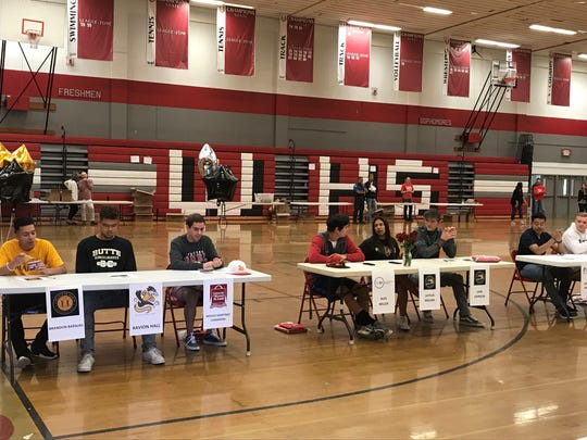 Wooster had 11 students sign to continue their athletic careers in college during a school assembly Friday morning.