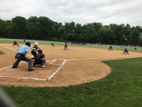 Action from Saturday's Class D softball quarterfinal